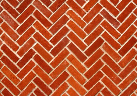 Abstract close up of a zigzag pattern red brick wall. photo