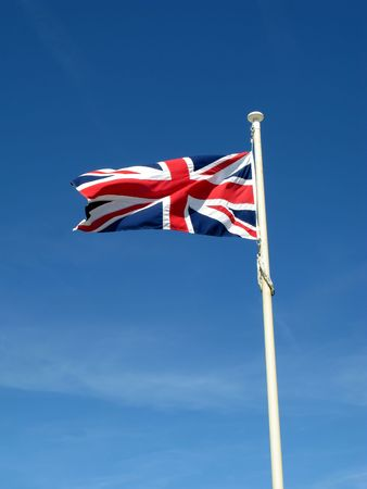 The Union Flag of Great Britain blowing in the wind. photo