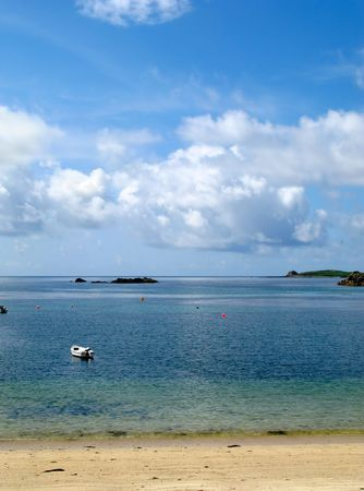 White clouds and blue sky over a calm sea, Porthcressa St. Mary's Isles of Scilly. Stock Photo - 3275001