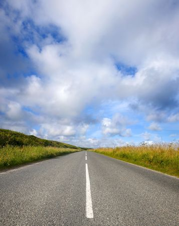 An empty English countryside road and a big sky in Cornwall. photo