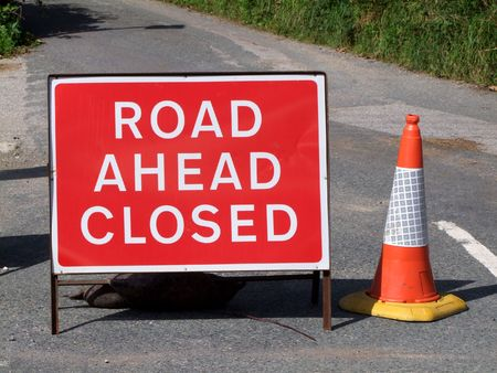 Road ahead closed sign.