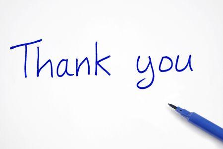 written communication: Thank you, written with a blue felt tip pen. Stock Photo