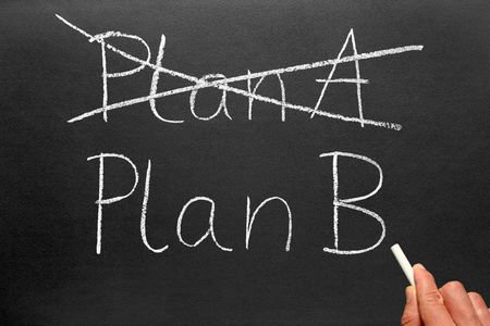 Crossing out Plan A and writing Plan B on a blackboard. Stock Photo