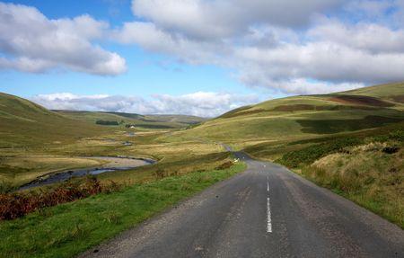 elan: Countryside road alongside the river Elan in Wales, UK.  Stock Photo