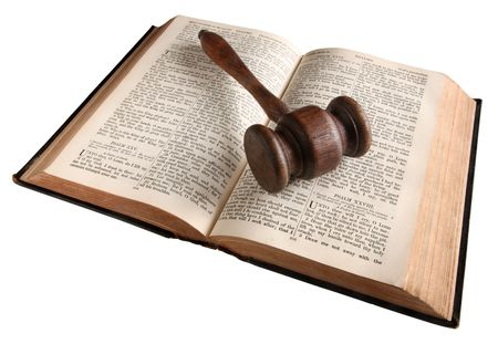 legislation: A wooden judges gavel on an 1882 bible.