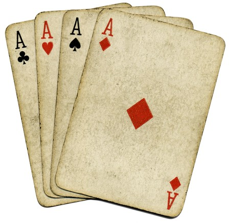 card game: Four old vintage dirty aces poker cards, isolated over white.