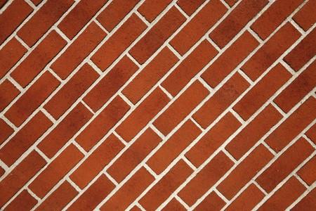 diagonally: Modern red brick wall sloping diagonally.