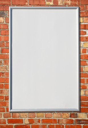 brickwall: White blank billboard sign on a red brick wall.