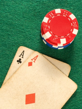 Two old poker card aces and colorful poker chips. Stock Photo - 4118344