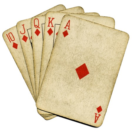 Royal flush old vintage poker cards isolated over white. Stock Photo