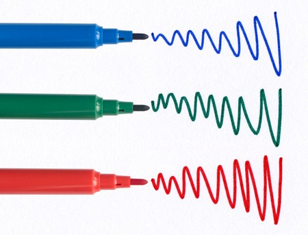 squiggles: Red green and blue felt tip pen squiggles on white paper.