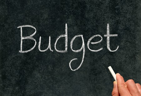 Budget, written with white chalk on a blackboard. Stock Photo