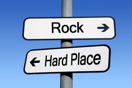 between: Between a rock and a hard place.
