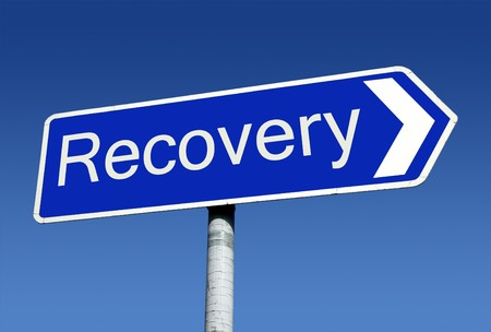 economic recession: Signpost along the road to recovery. Stock Photo