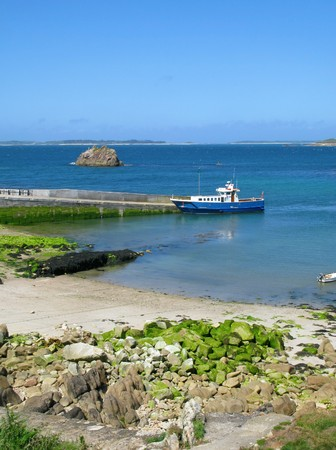 An inter-island boat at St. Agnes quay, Isles of Scilly, Cornwall UK. Stock Photo - 4312668