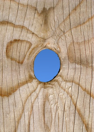 A peep hole in a wooden fence. Stock Photo - 4539711