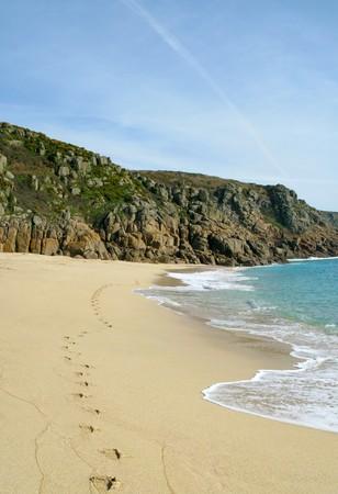 porthcurno: Footprints along Porthcurno beach, Cornwall UK. Stock Photo