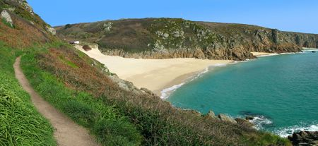 cornwall: Panoramic view of the coast path to Porthcurno beach, Cornwall UK.