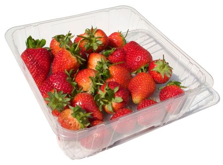 A punnet of fresh strawberries isolated on white. photo