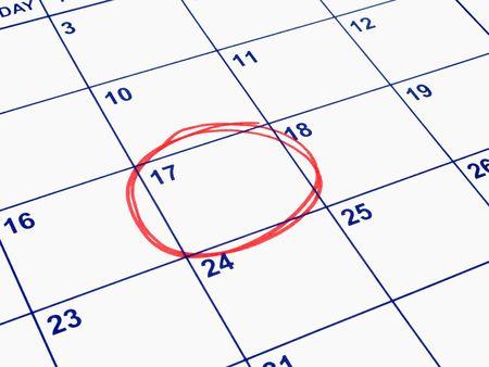 circled: Una fecha en c�rculos sobre un calendario.