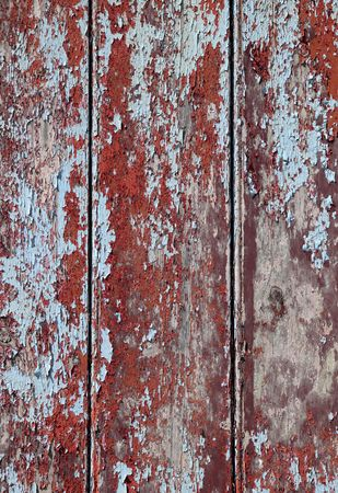 Rough peeling red and blue paint texture background. photo