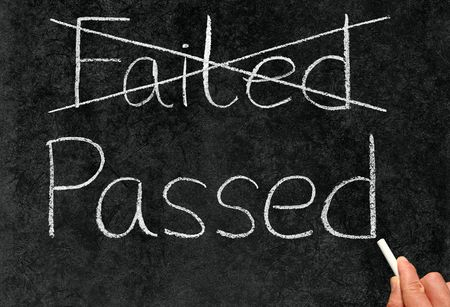 Passed out: Crossing out failed and writing passed on a blackboard.
