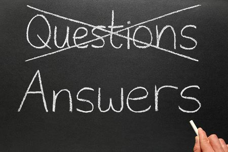 cliche': Crossing out questions and writing answers on a blackboard.