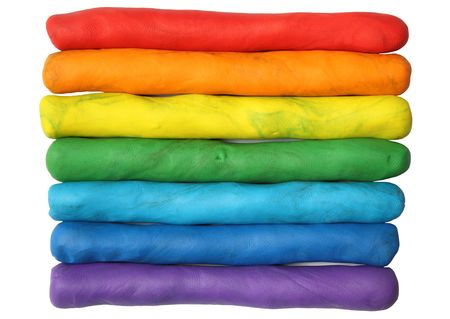Rainbow colors plasticine play dough modeling clay isolated over white. Stock Photo