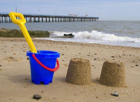 felixstowe: Kids bucket, spade and sandcastles on Felixstowe beach.