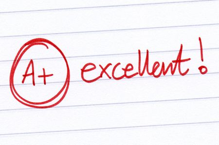 A+ excellent written on an exam paper. Stock Photo - 5451335