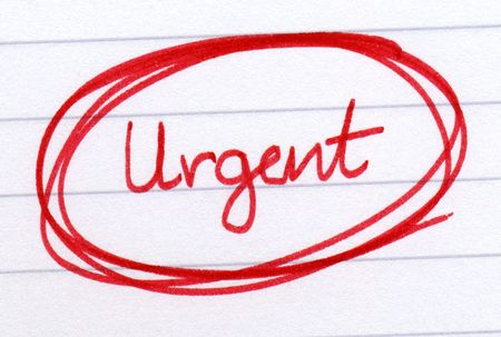 circled: Urgent circled in red ink on white paper. Stock Photo