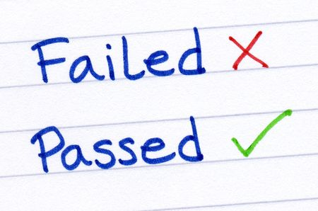 passed: Failed and passed written on white paper.