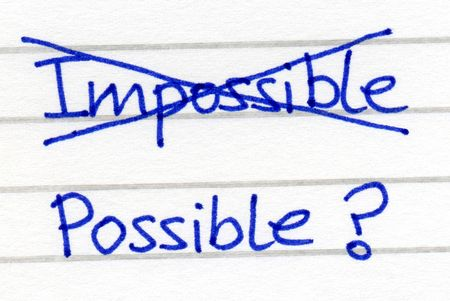 impossible: Crossing out impossible and writing possible. Stock Photo