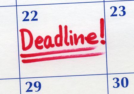 Deadline day written on a calendar. photo