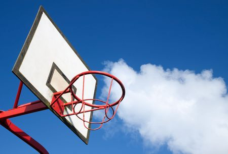 Park basketball ring close up and blue sky. photo