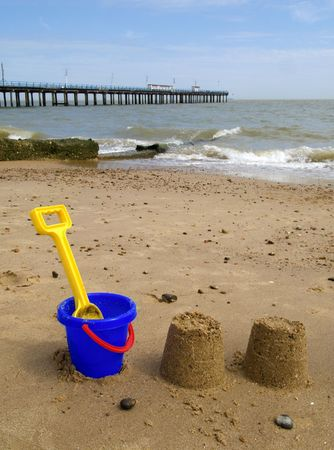 sandcastles: Kids bucket, spade and sandcastles on Felixstowe beach.