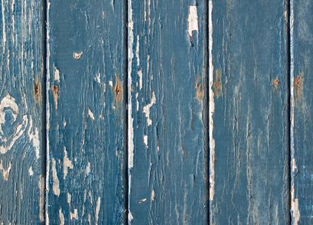 flaky: Blue flaky paint on a wooden fence.
