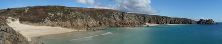 porthcurno: Panoramic view from Porthcurno beach to Logan rock. Stock Photo