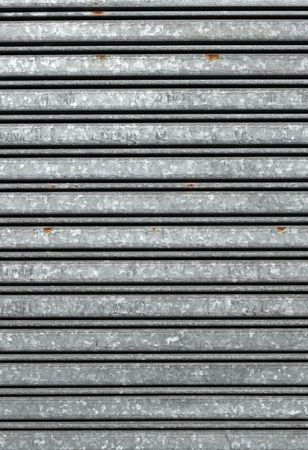 security shutters: Close up of shop warehouse security shutters.