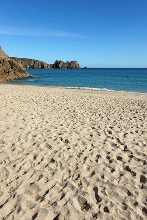 Porthcurno sandy beach and Logan rock in Cornwall UK. Stock Photo - 6864091