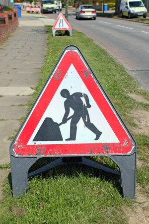 roadworks: British roadworks sign on the side of a road.