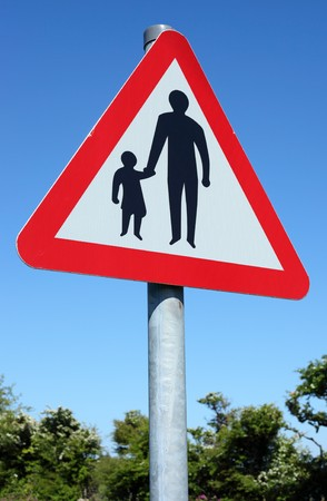 english countryside: British pedestrians in road sign and blue sky.