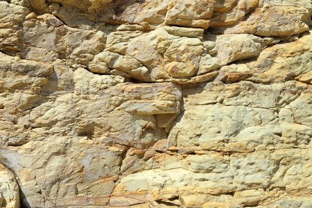 Cliff rock face being eroded by the sea. Stock Photo