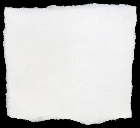 White torn square of paper isolated on a black background. Stock Photo