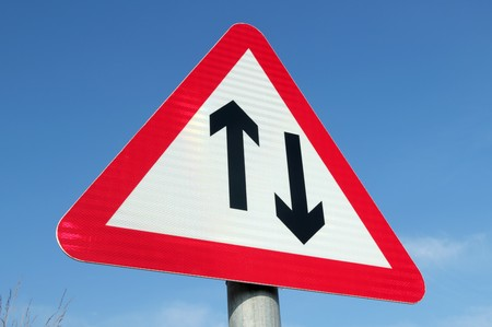 British two way traffic ahead sign. photo