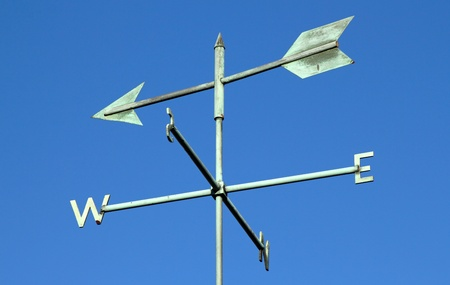 Weather vane and blue sky. photo