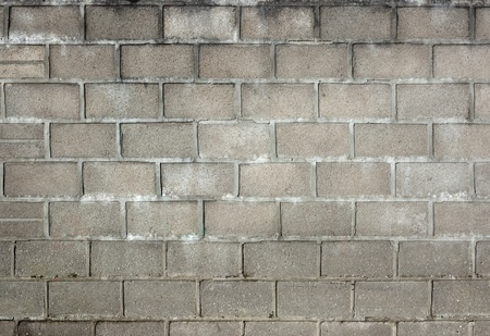 Old dirty gray breeze blocks wall background. Stock Photo
