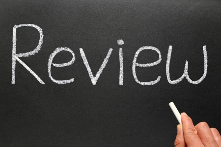 reviewing: Writing review with white chalk on a blackboard.