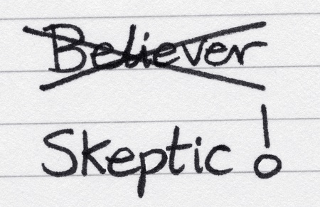 skeptic: Crossing out believer and writing skeptic.