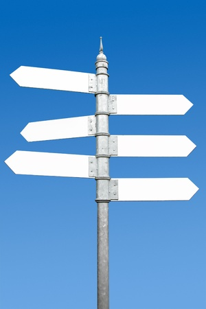 Multidirectional six way signpost with blank spaces for text. Stock Photo